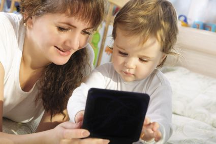 mom and baby with tablet