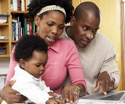 black family with laptop